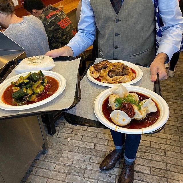 Waiter Bringing Out Food At A Restaurant